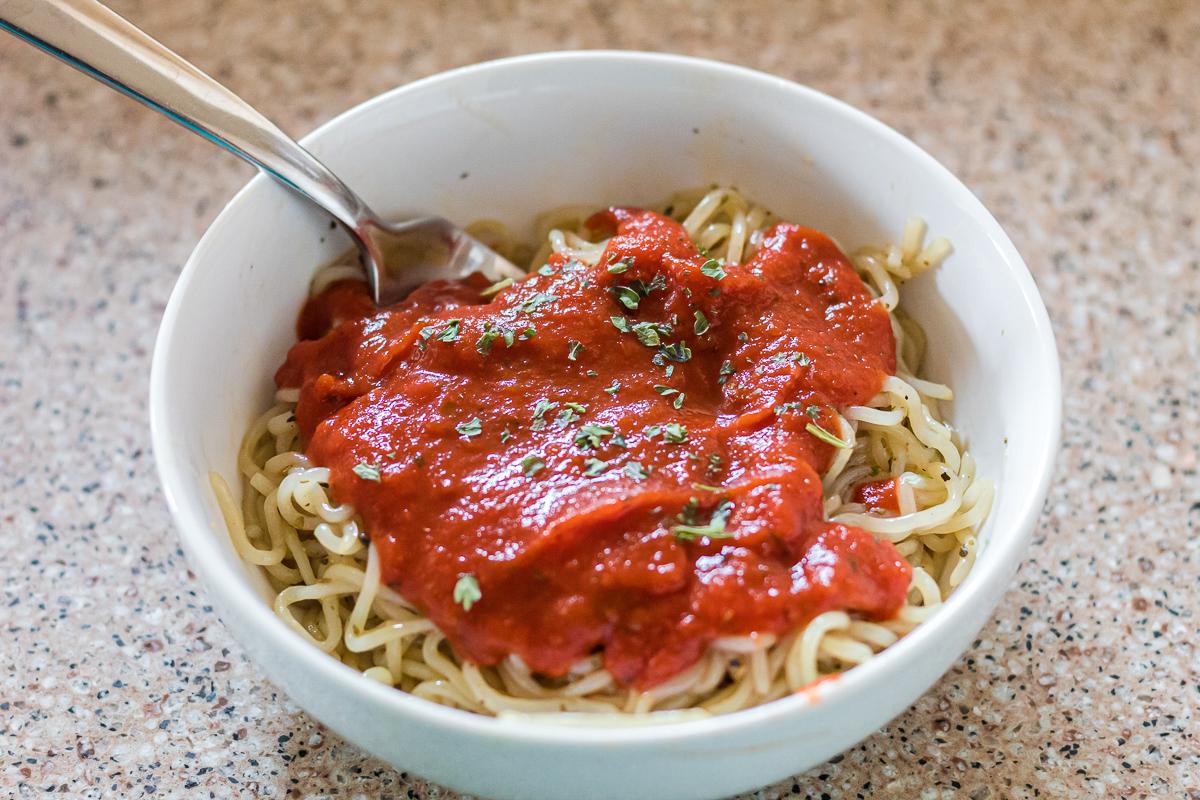 bowl of shirataki noodles with spaghetti sauce