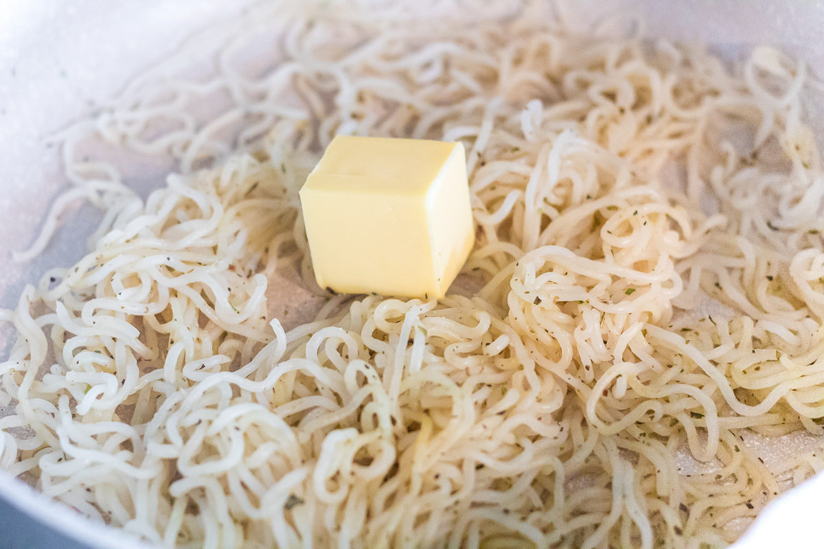 shirataki noodles in a skillet with butter