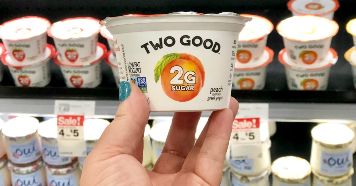 holding Two Good yogurt cup at Target