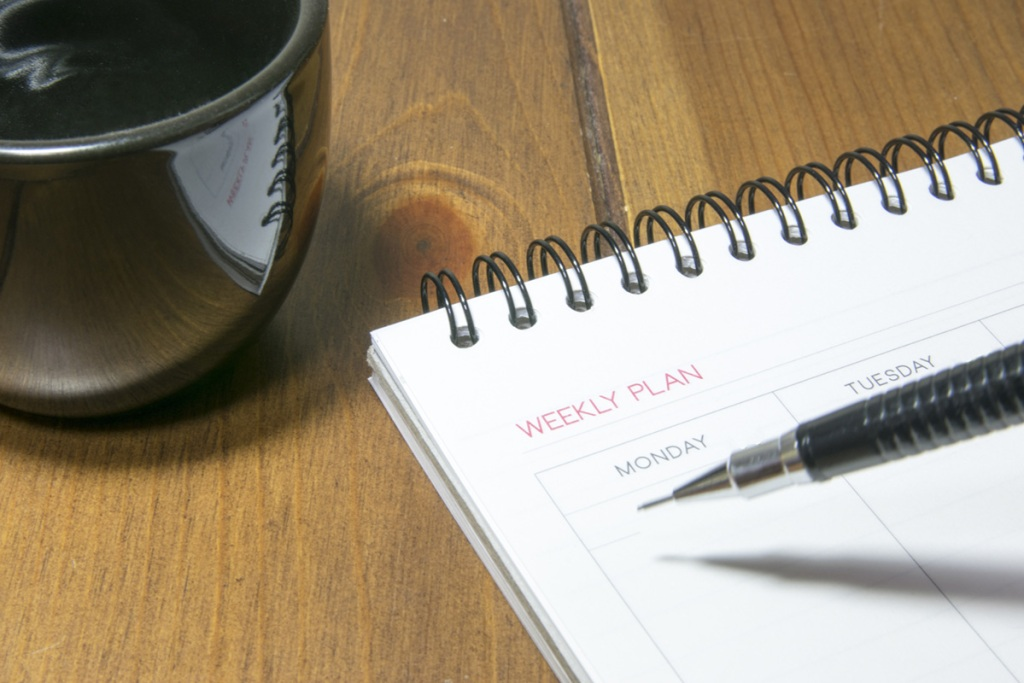 calendar on desk with cup of coffee