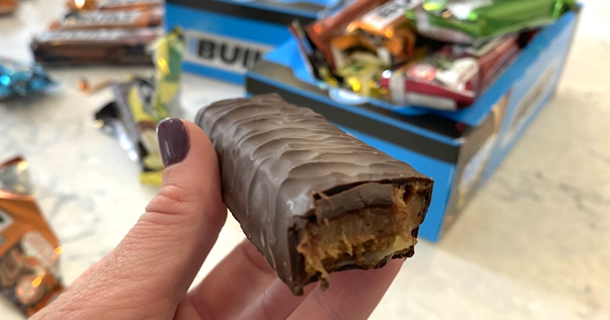 holding Built bar chocolate protein bar