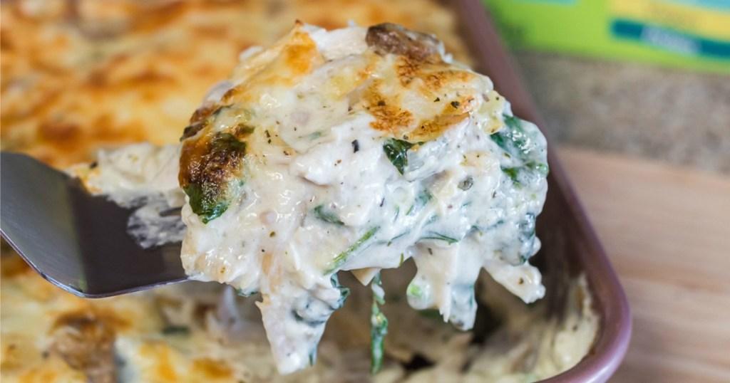 scooping up keto chicken lasagna with spatula
