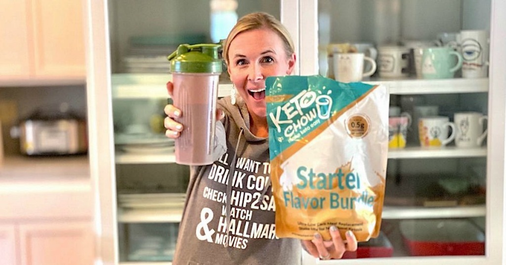 woman holding up keto chow shake and bag