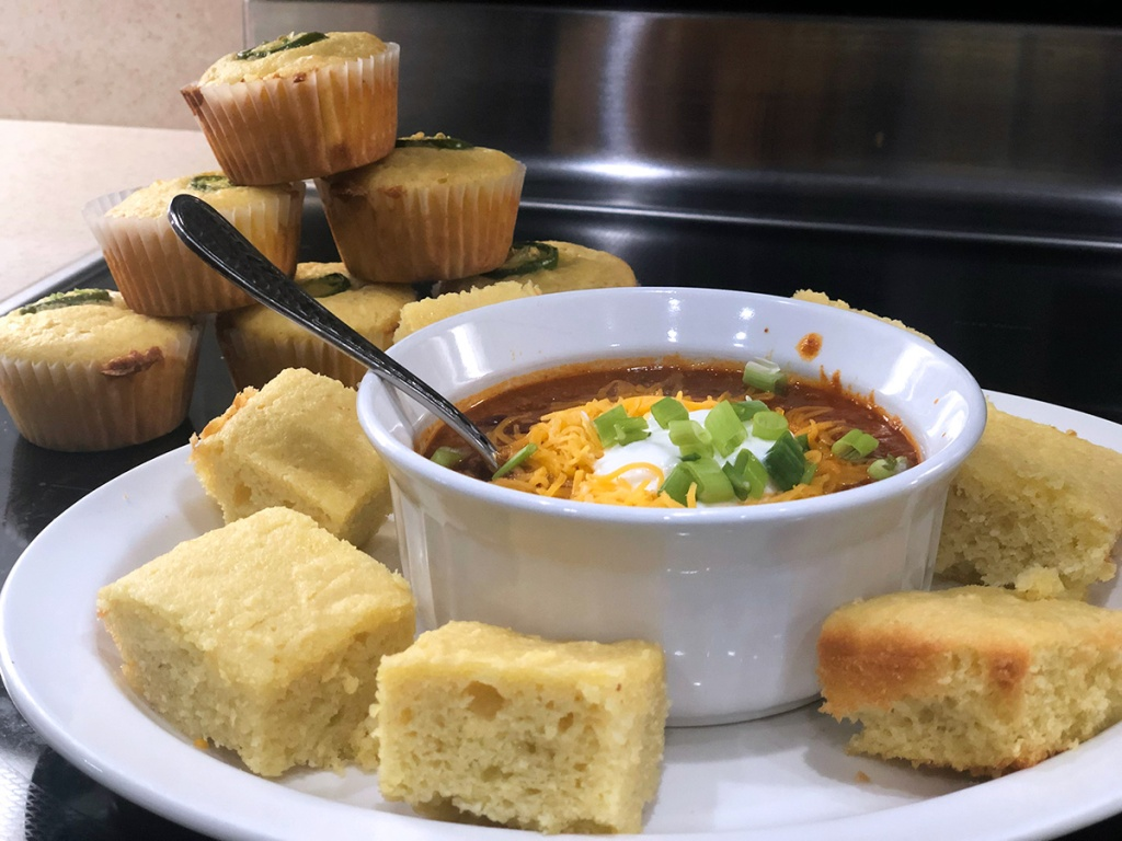 Keto cornbread muffins and pieces with chili