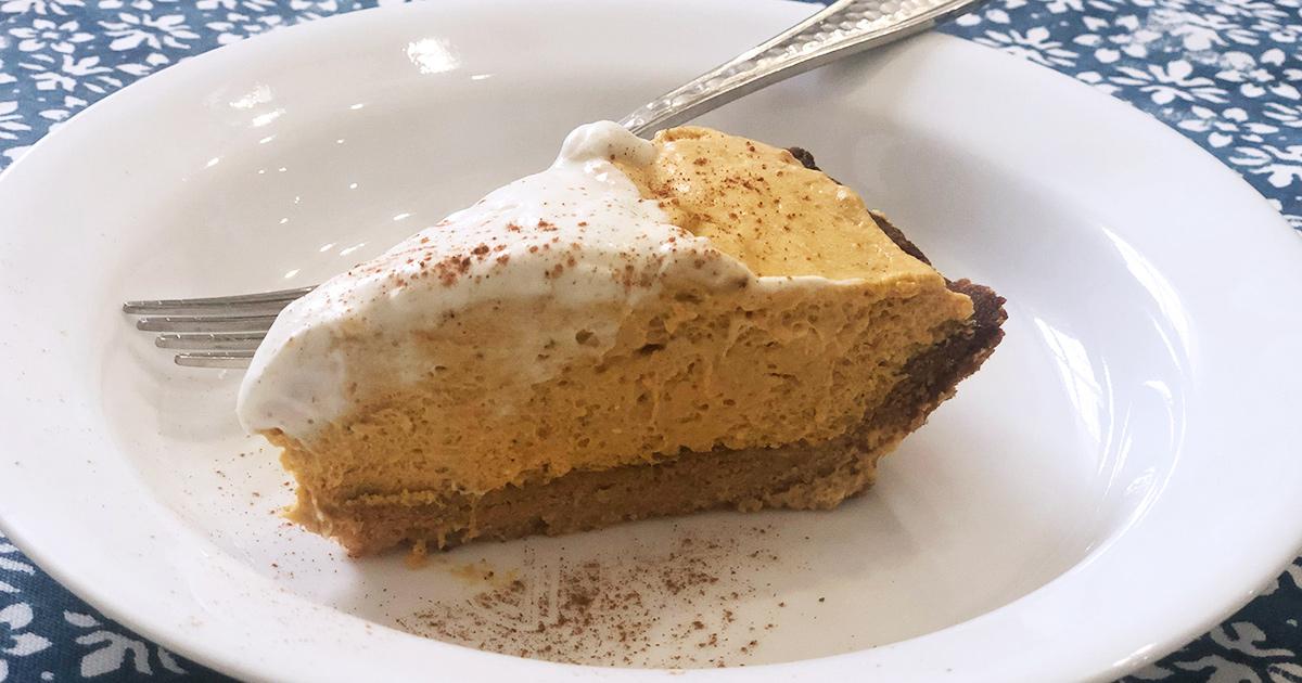 Keto Pumpkin Cream Pie slice on white plate