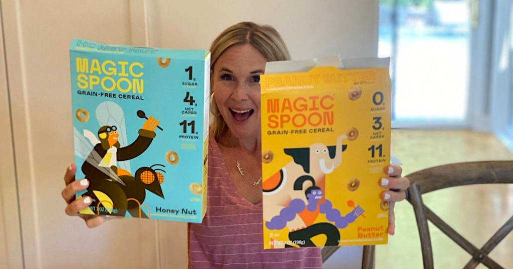 woman holding two boxes of Magic Spoon cereal
