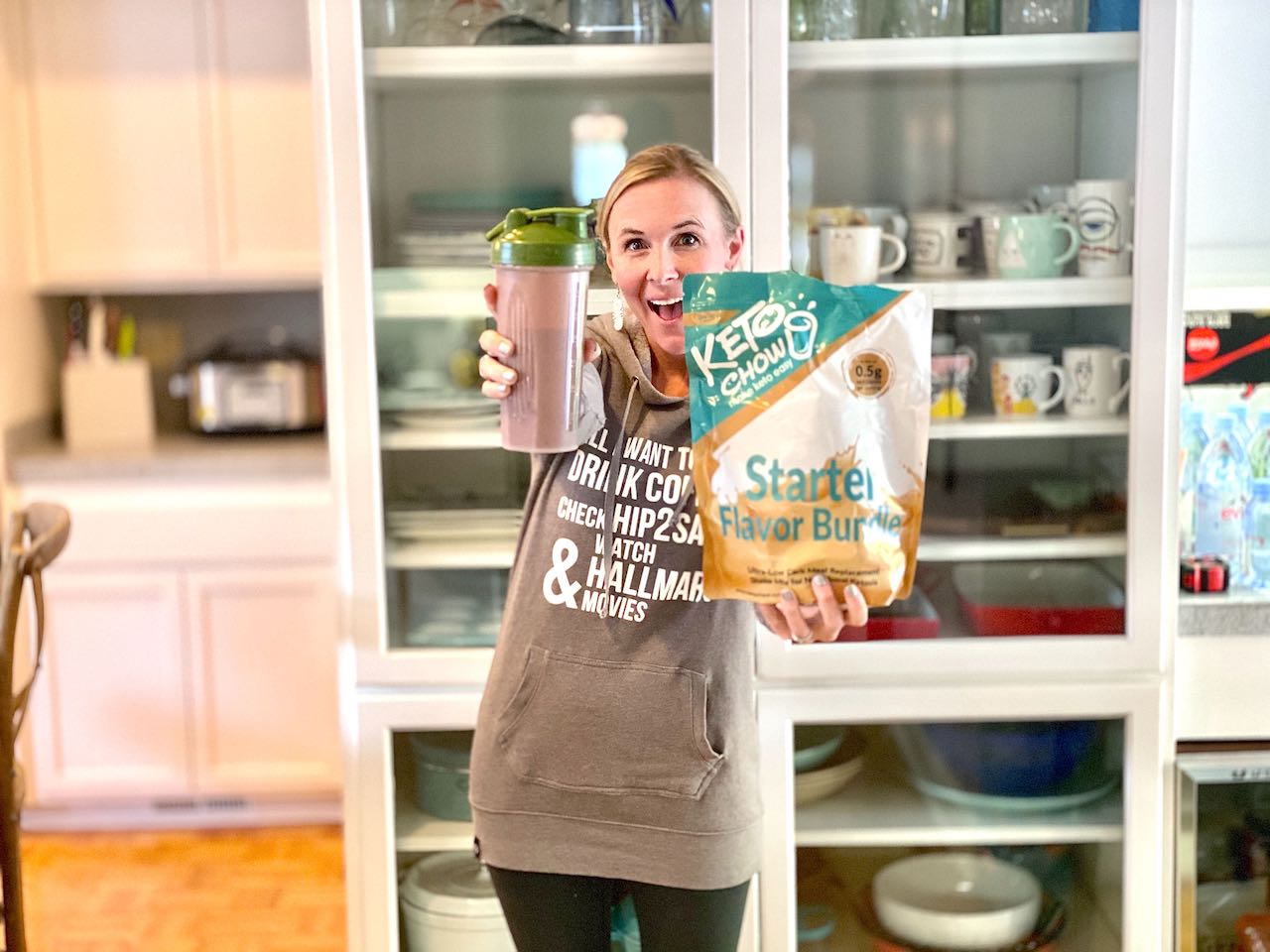 woman holding Keto Chow and shaker cup