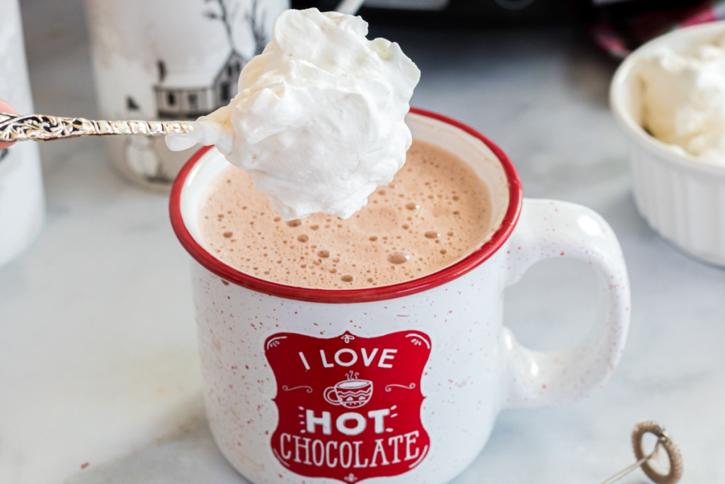 spoonful of whip cream in hot chocolate