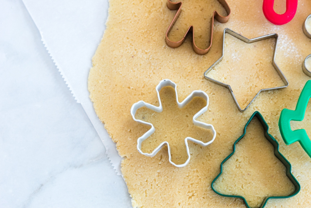 cookie cutters in cookie dough