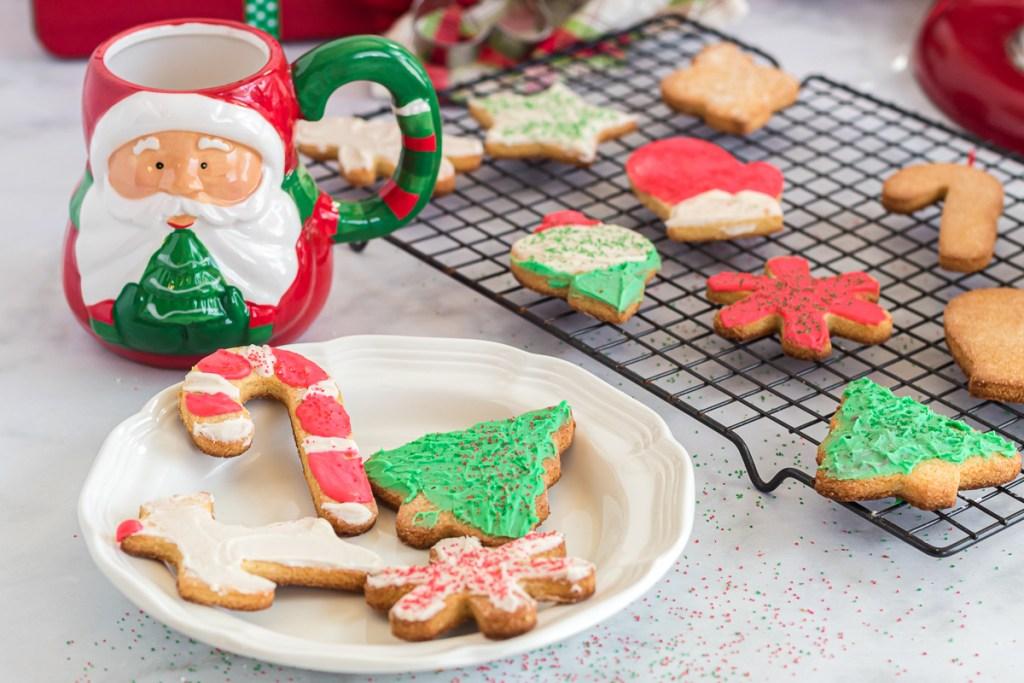 sugar cookies on a plate with a Santa mug