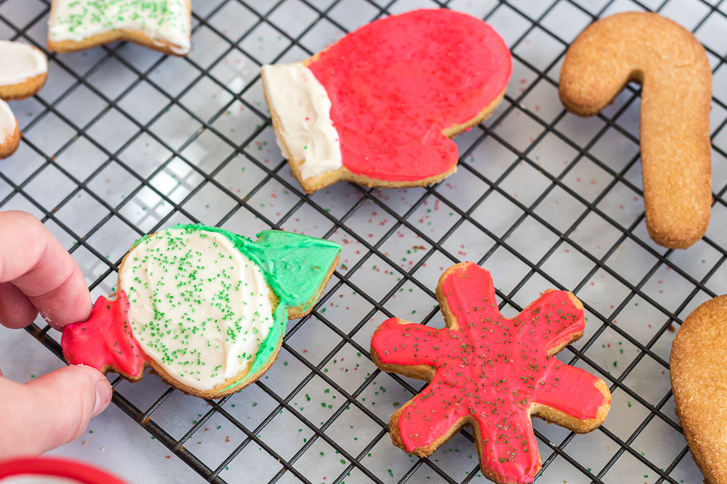 holding keo iced holiday sugar cookie