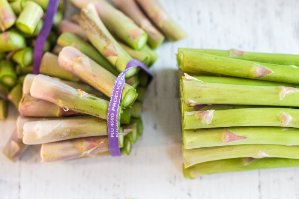 cutting against the band of asparagus stalks
