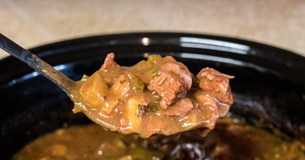 Spoonful of keto beef stew out of the crockpot