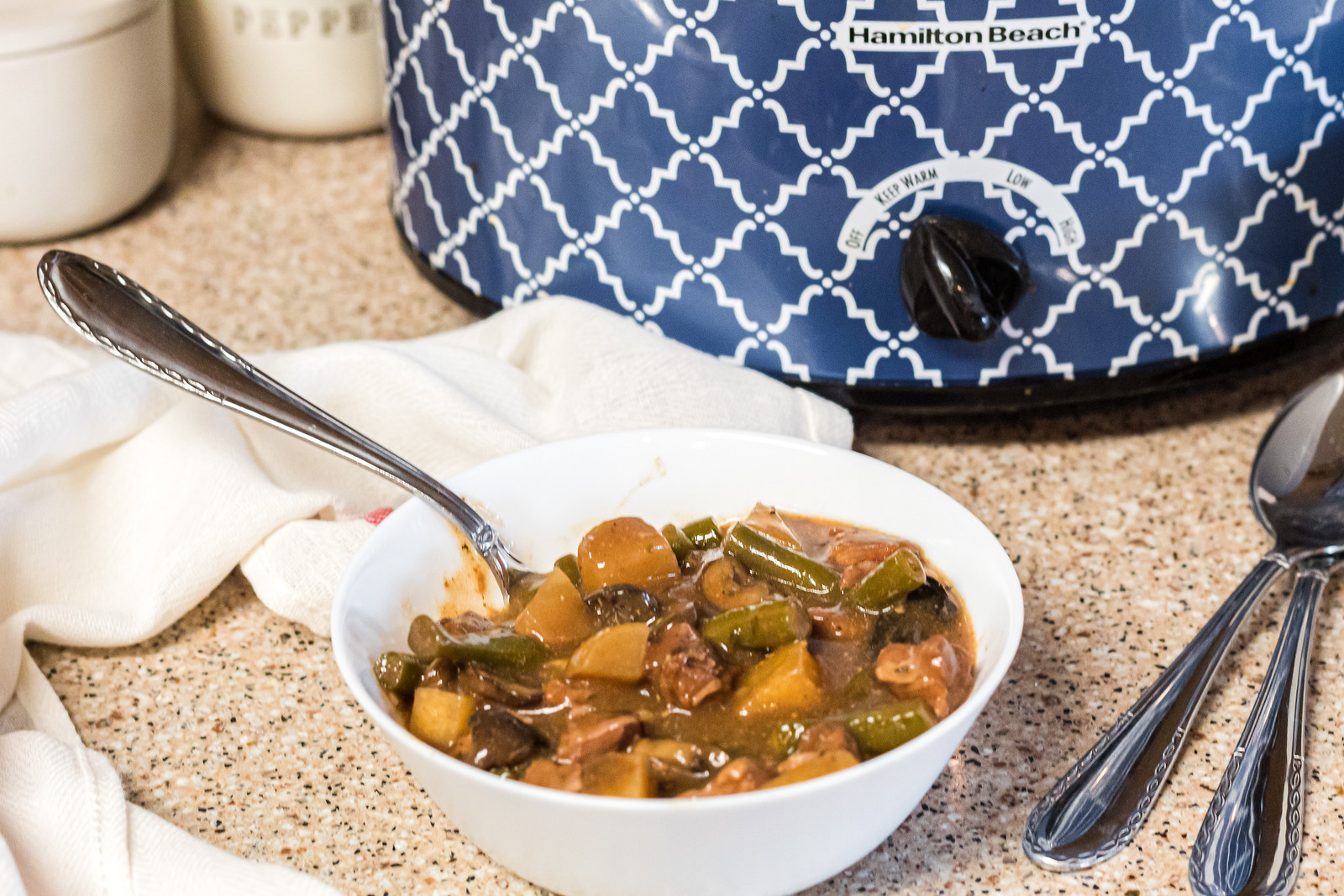 keto beef stew in a white bowl by Crockpot