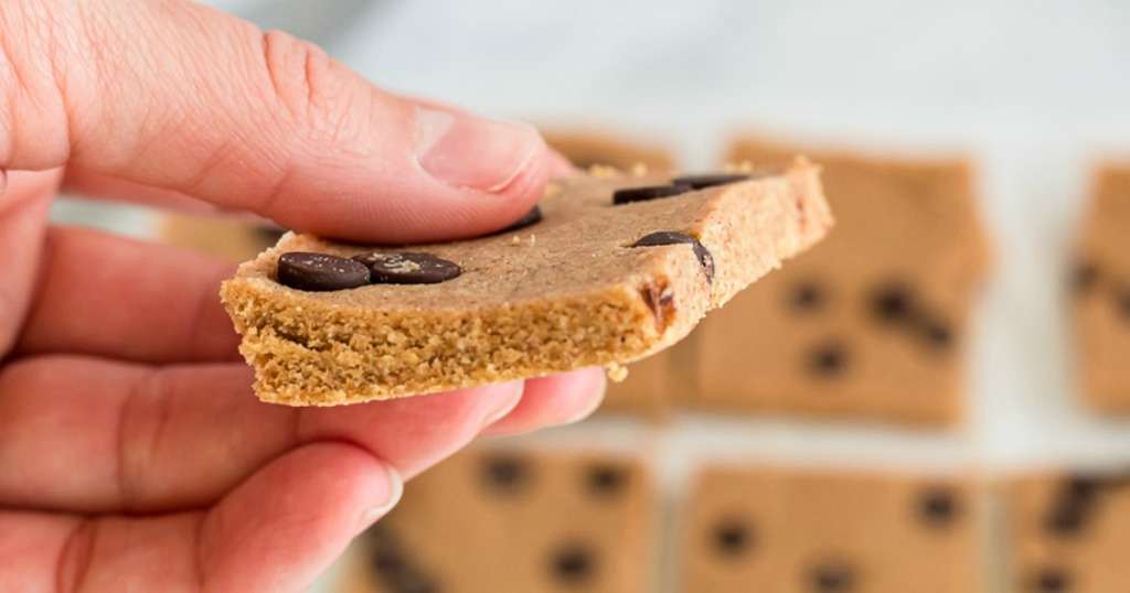 holding keto cookie dough chocolate chip protein bar
