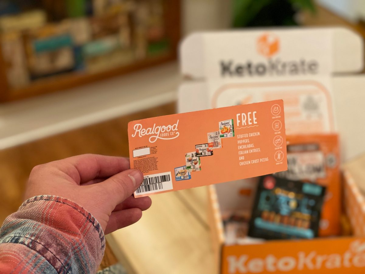 holding Realgood free product coupon with Keto Krate box in the background