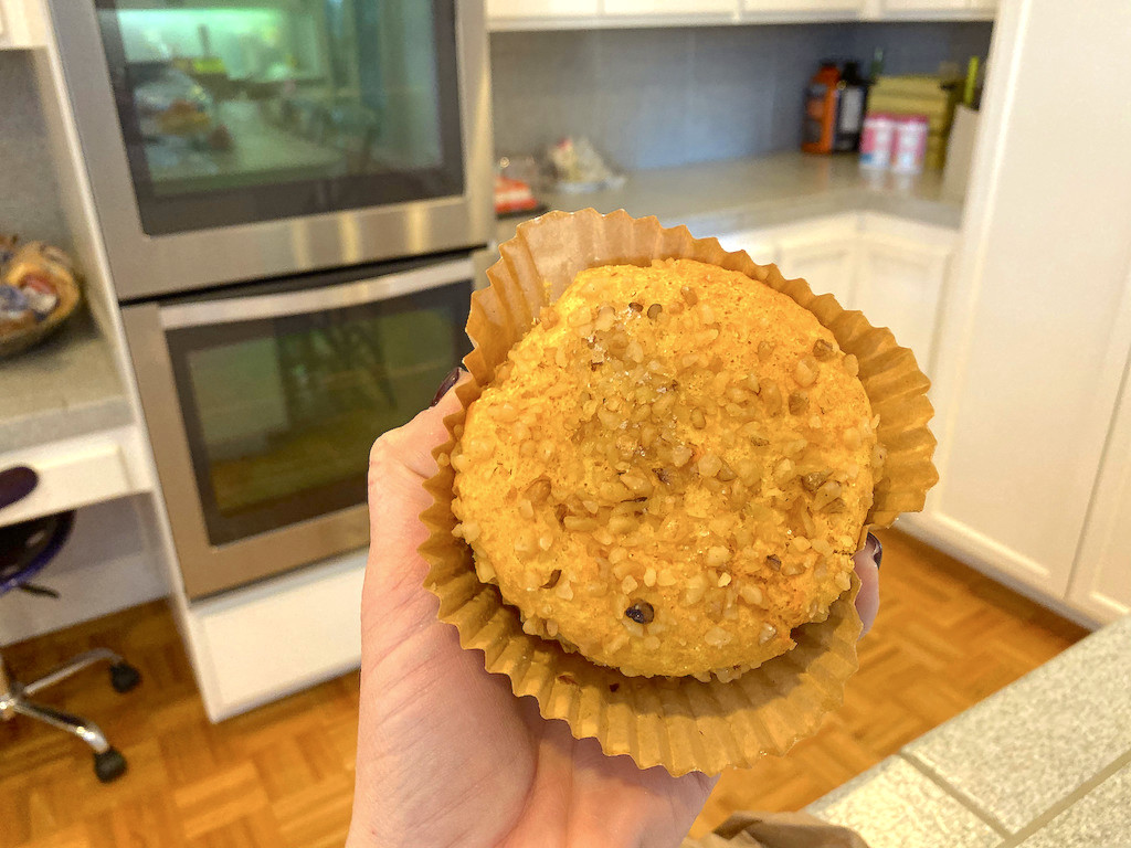 holding keto banana nut smart muffin