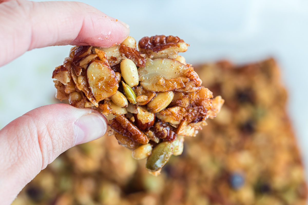 holding up chunk of keto trail mix
