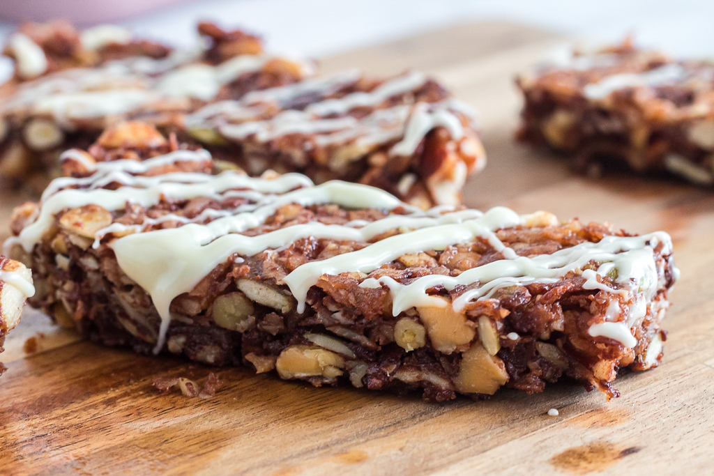 keto granola bars with white chocolate drizzled on top