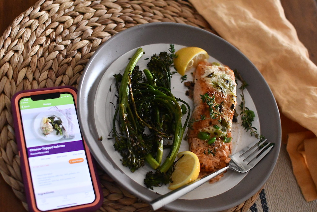 salmon on plate with eMeals app open on iPhone