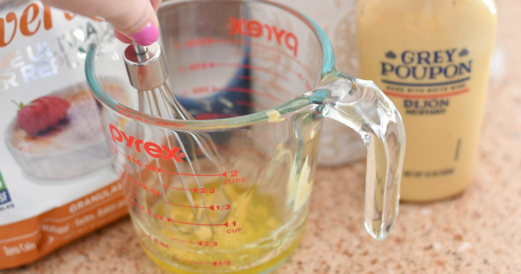 whisking together mustard and oil