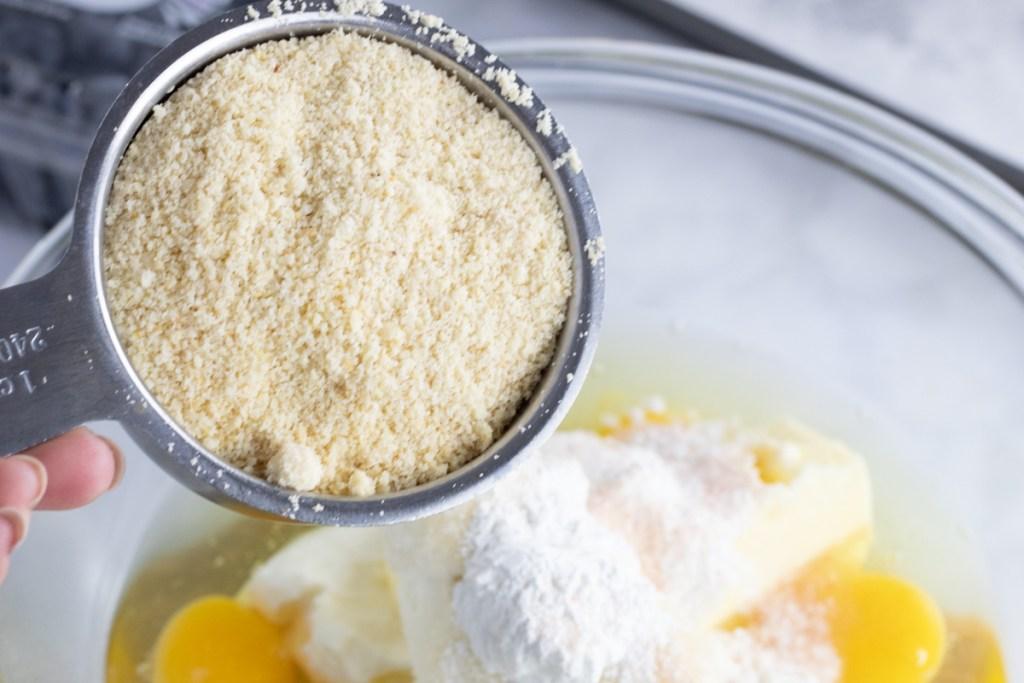 pouring almond flour into mix