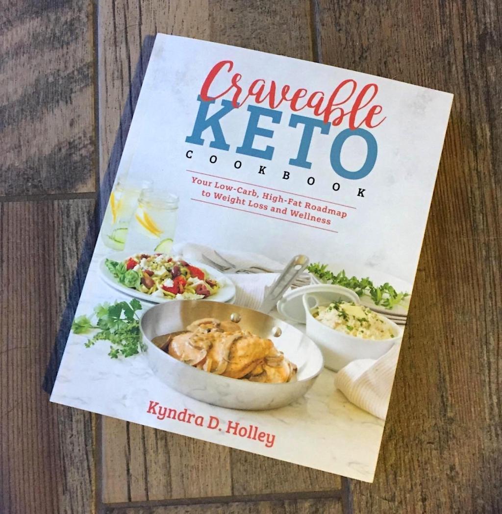 Craveable keto cookbook on wood floor