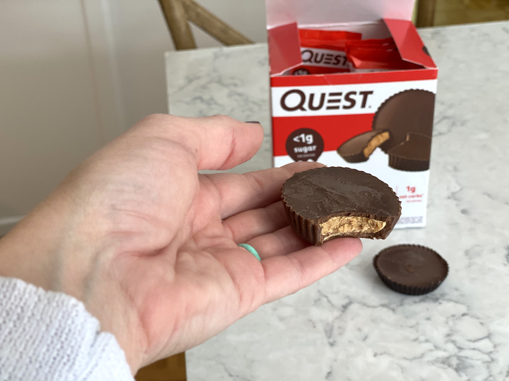 holding Quest peanut butter cups