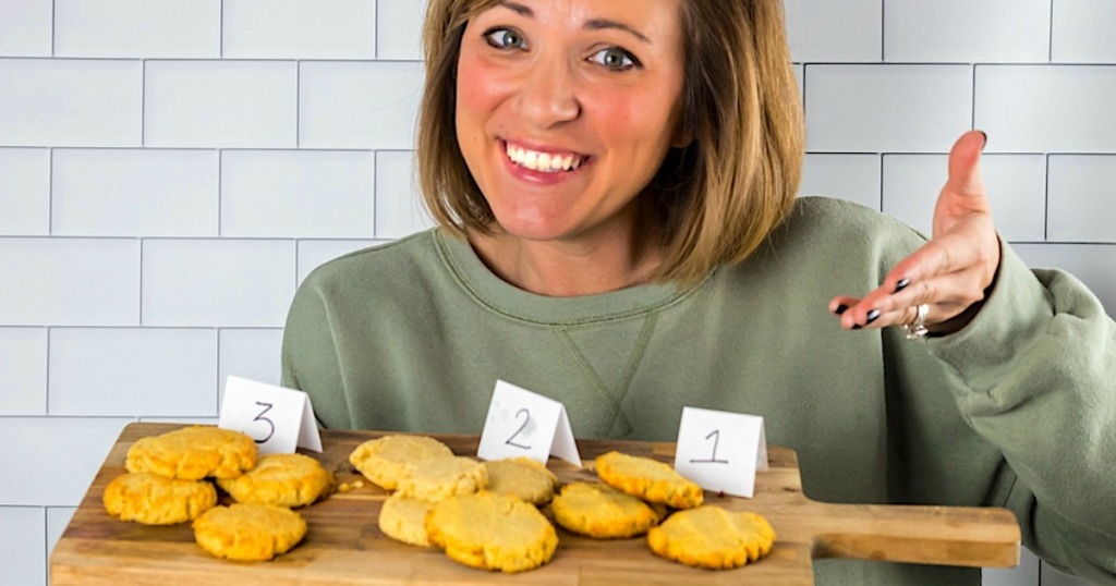 woman smiling while holding keto sugar cookies on tray
