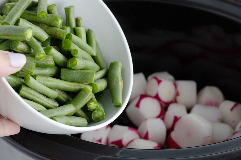 adding beans and radishes to Crock-Pot