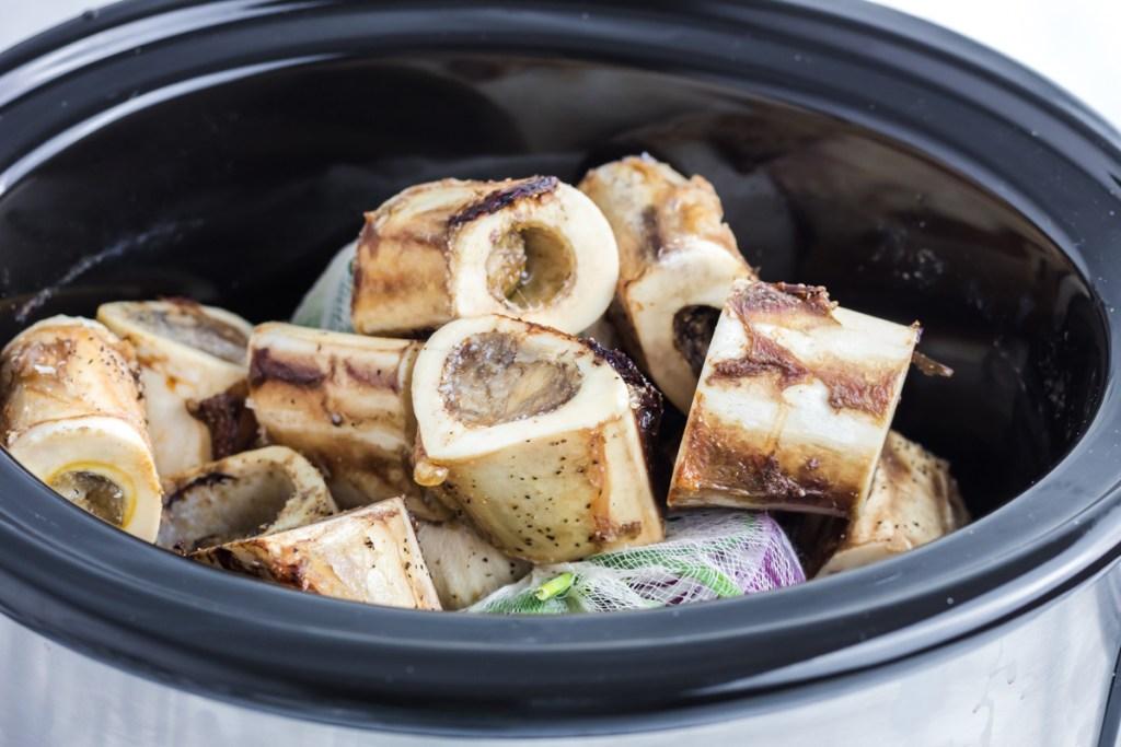 place meat bones in crock pot