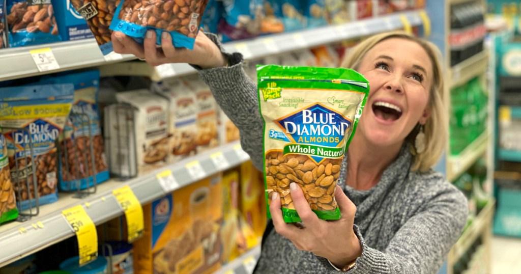woman holding bags of Blue Diamond almonds
