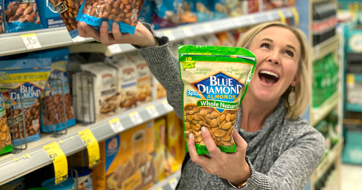 woman holding bags of Blue Diamond almonds