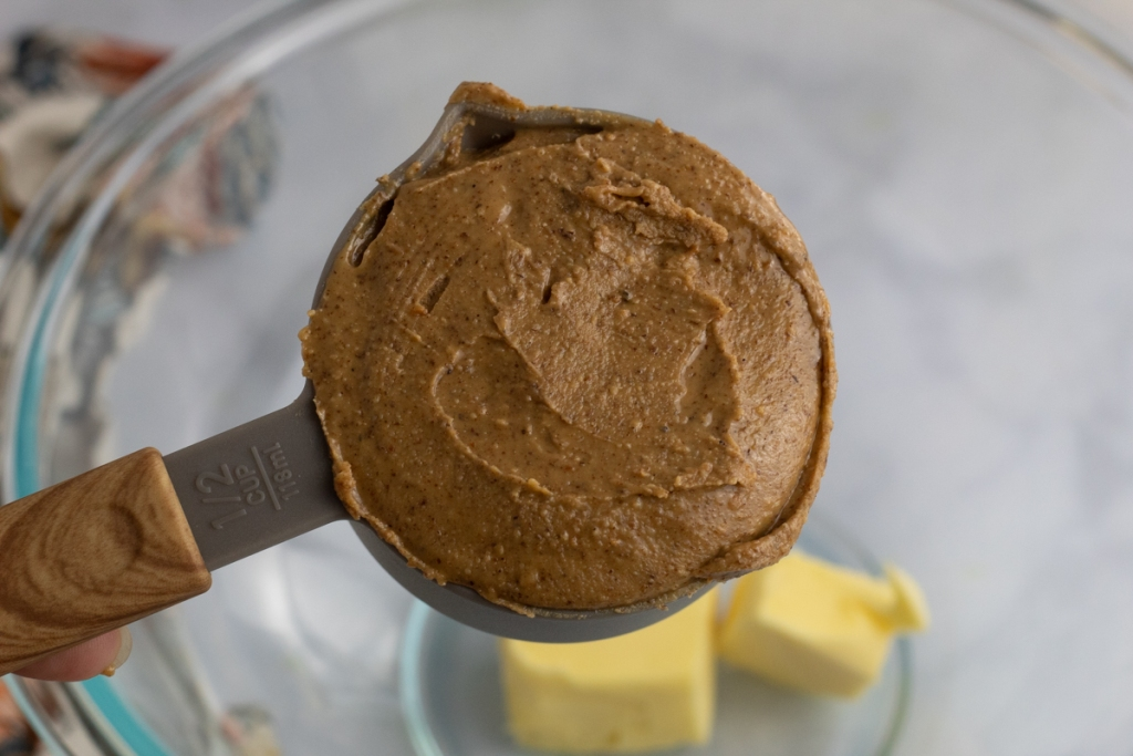 adding peanut butter to bowl