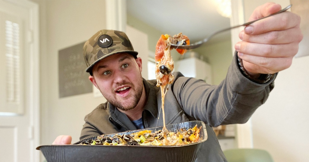 Man with Papa Murphys Keto Pizza