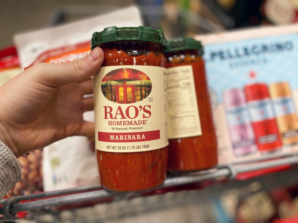 holding Rao's sauce at Costco