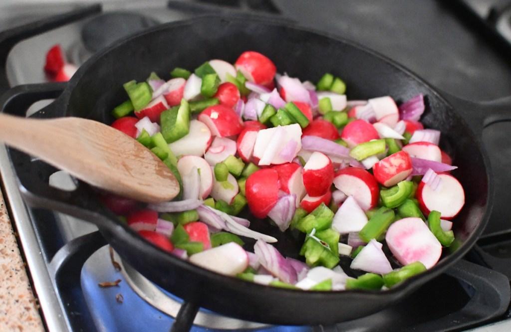 breakfast burrito ingredients in skillet