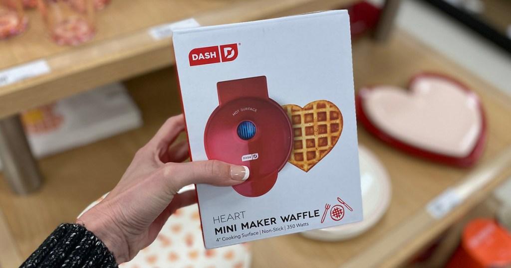 hand holding dash mini heart waffle maker