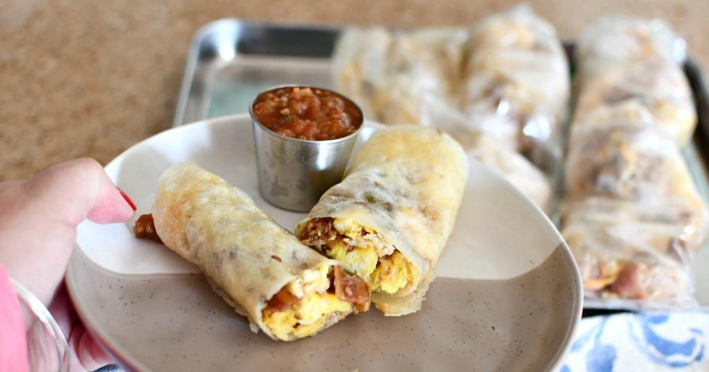 holding a keto breakfast burrito