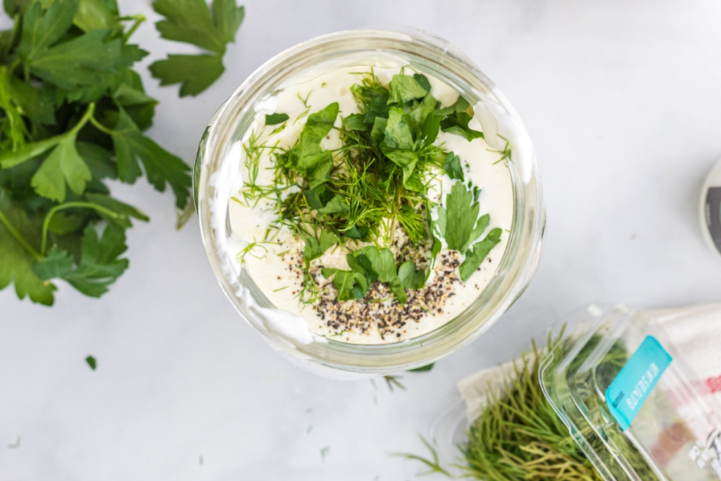 ingredients in a mason jar for ranch dressing