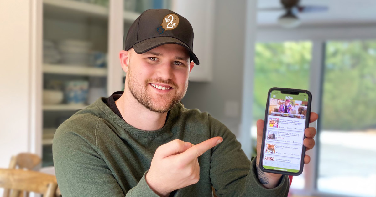 man holding phone with hip2keto app