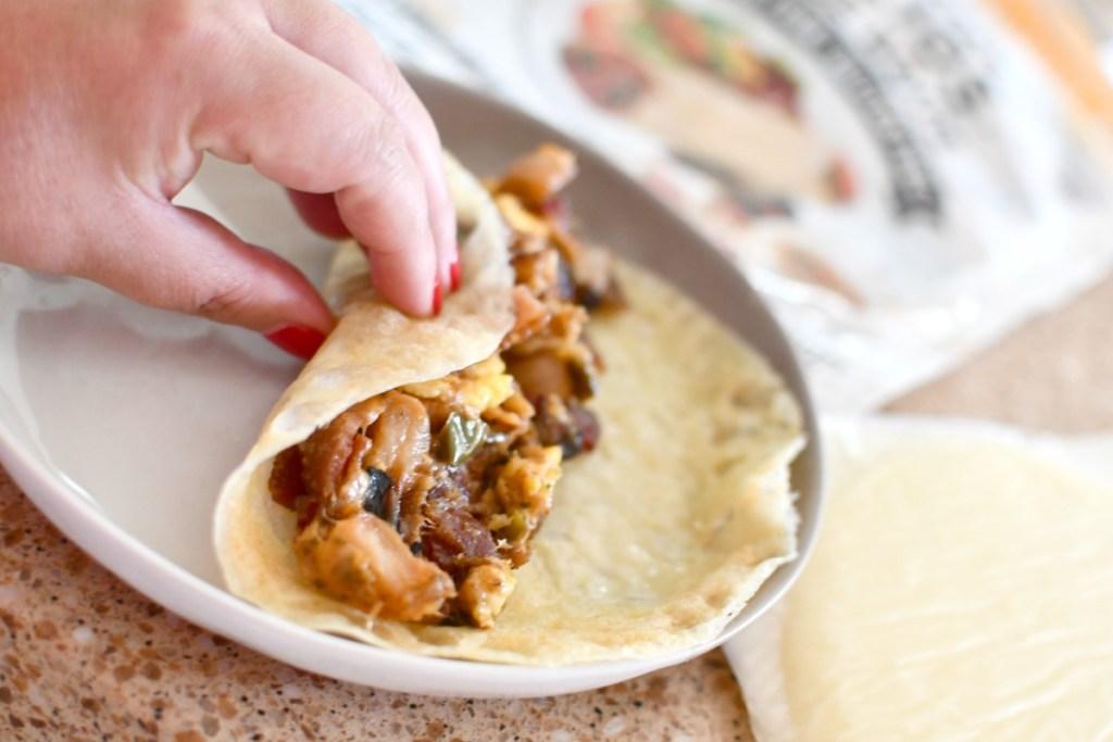rolling a breakfast burrito in a folio wrap