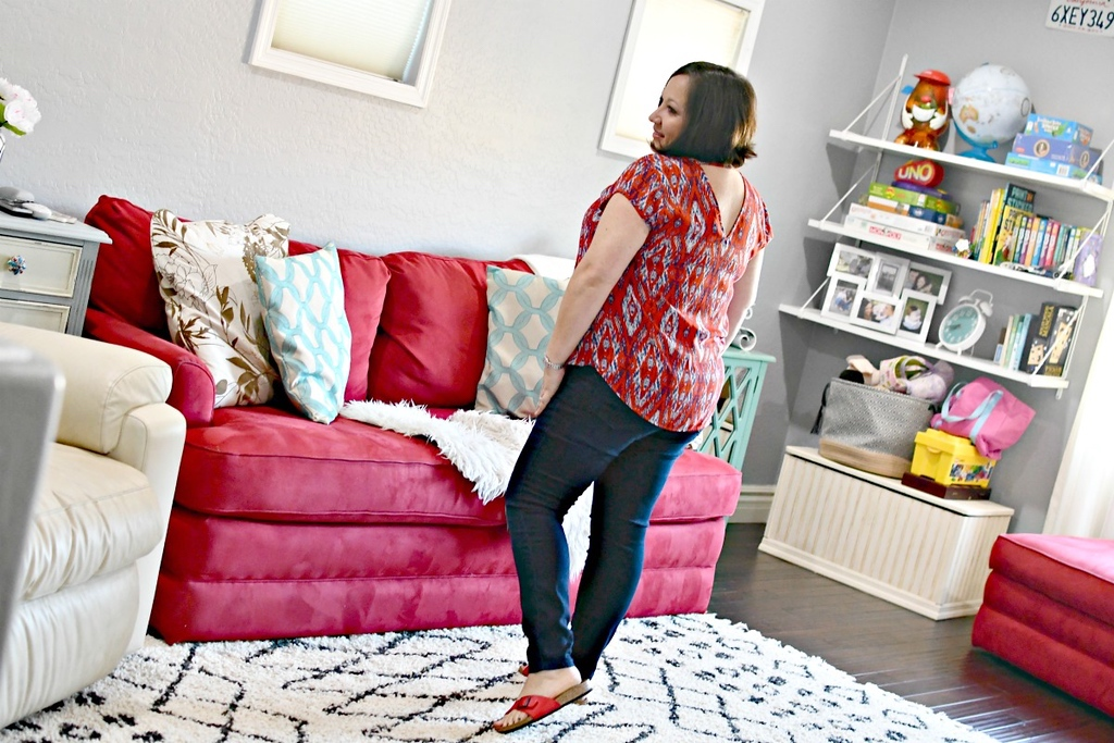 woman wearing jeans in living room
