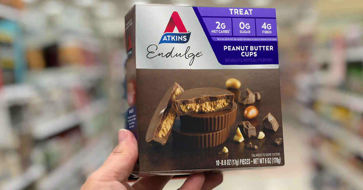 Person holding atkins peanut butter cups