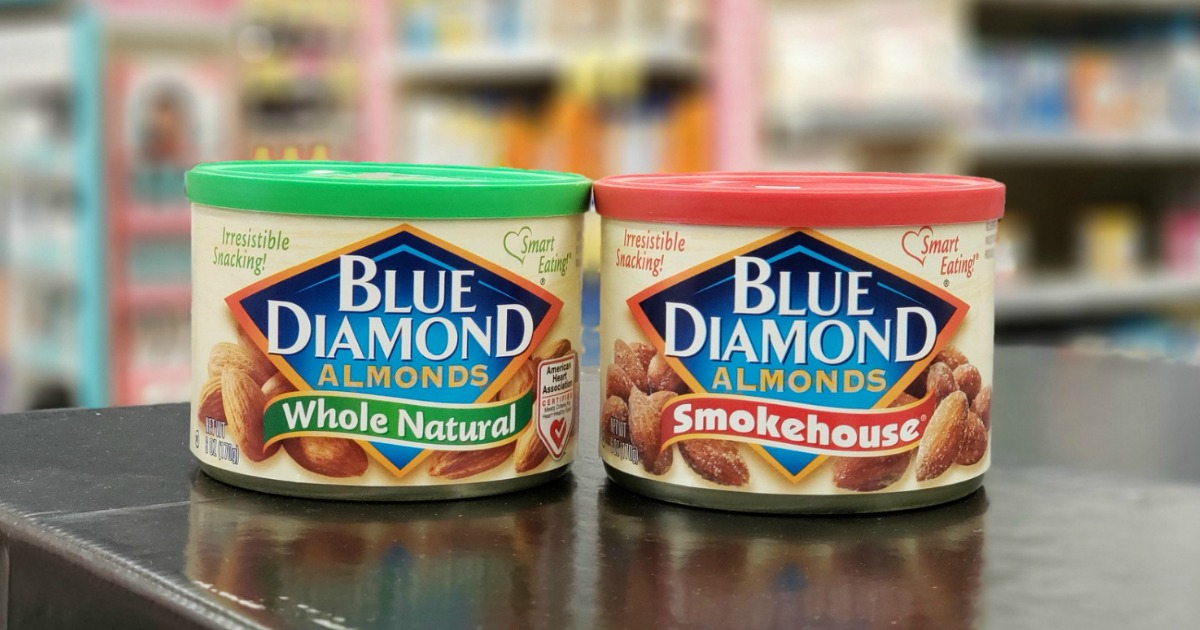 2 small cans of blue diamond almonds sitting on store shelf