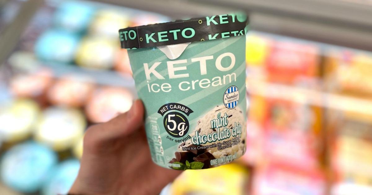 holding carton of keto ice cream at ALDI