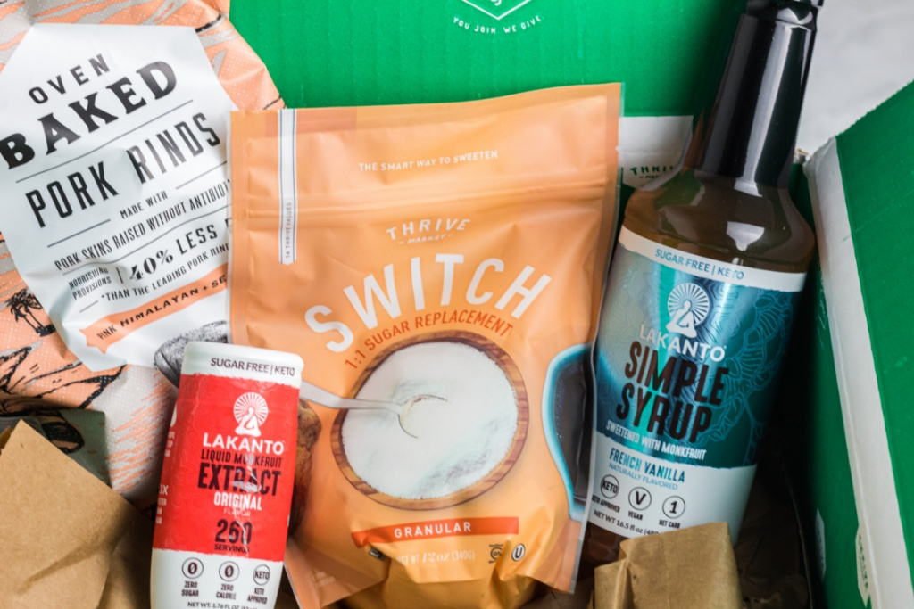 keto groceries, pork rinds, and sugar alternatives next to thrive market box