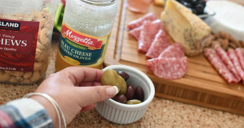 adding olives to charcuterie