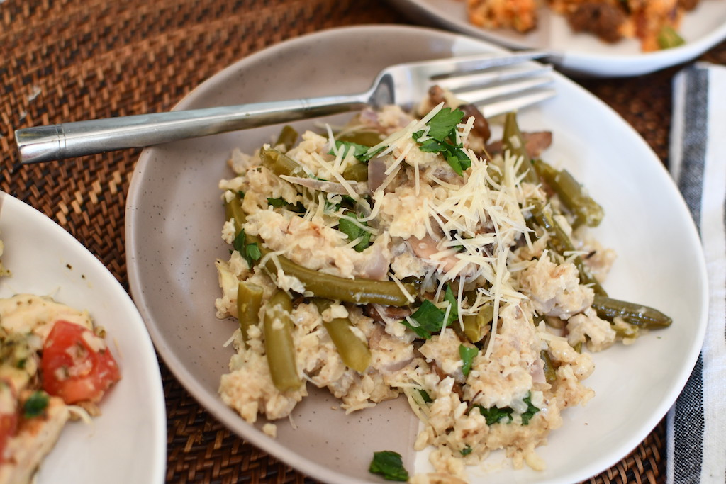 cauliflower rice with green beans in a bowl