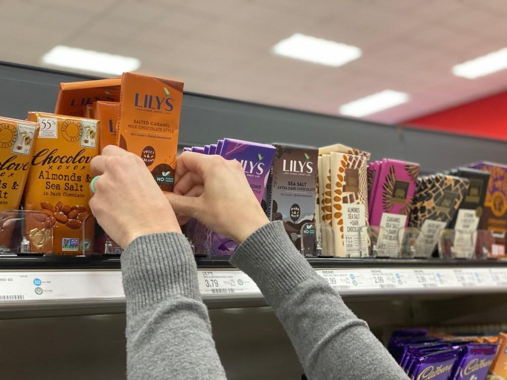 grabbing Lily's chocolate bar off Target shelf